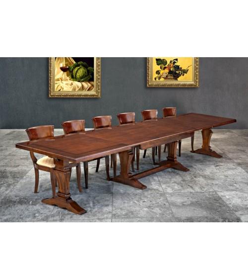 Tavolo classico con greca intarsiata e quattro allunghe